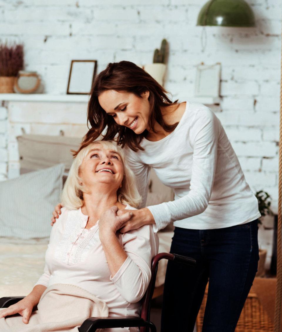 female senior smiling at her caregiver