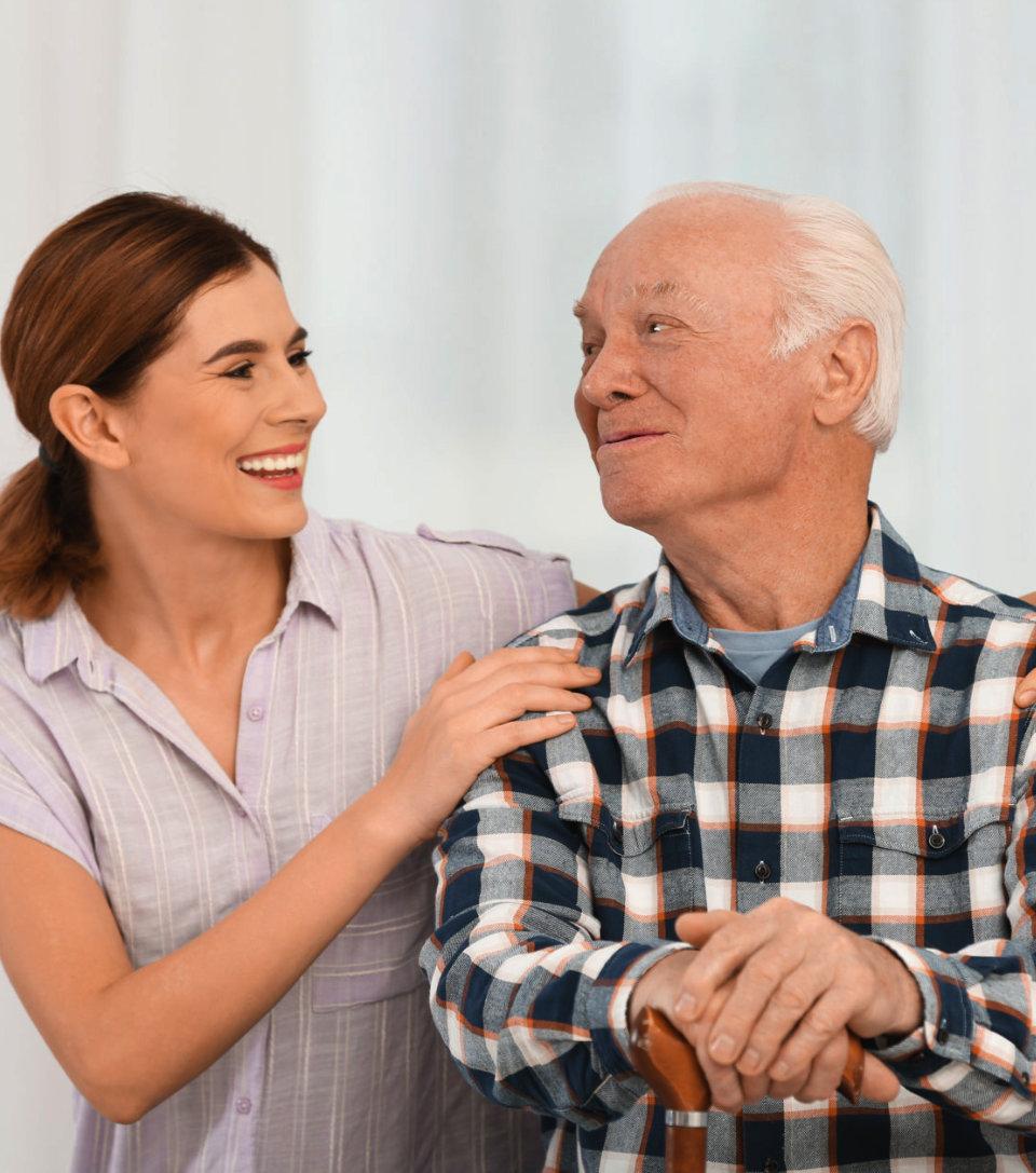 caregiver holding senior man