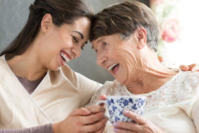 senior woman smiling while having a tea