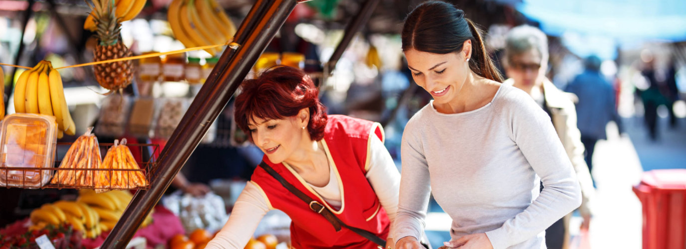 senior woman and caregiver on shopping